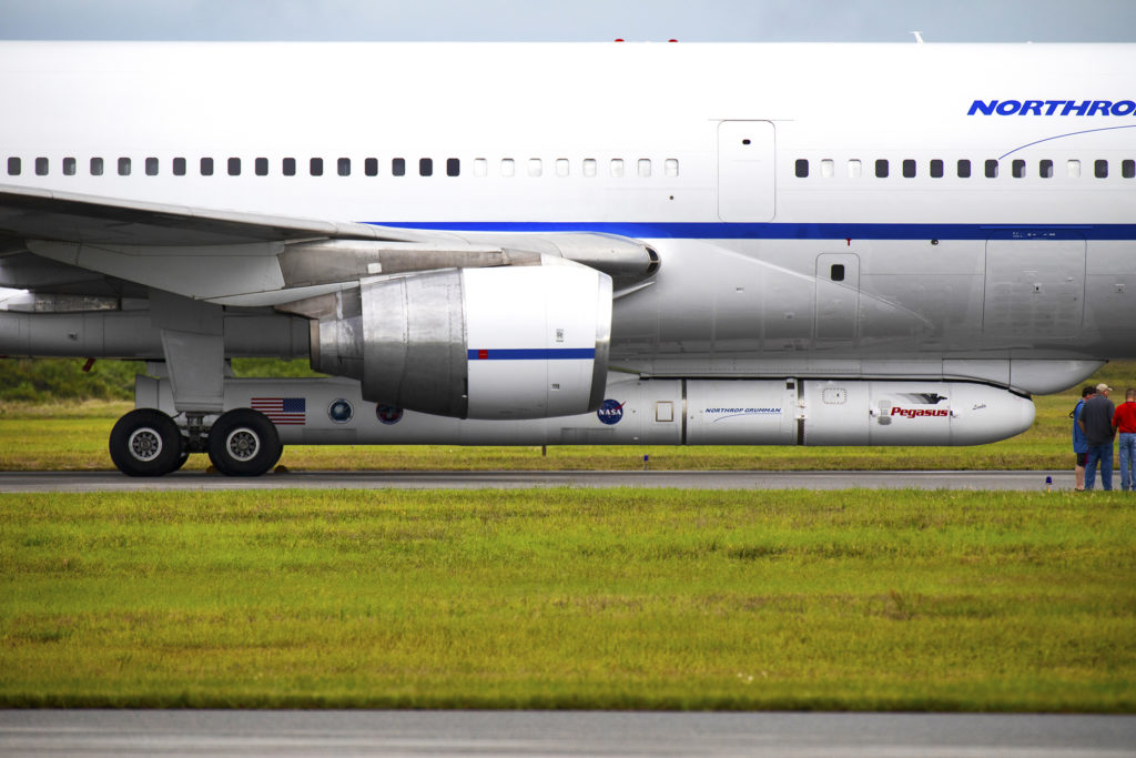 Northrop Grumman's L-1011 Stargazer aircraft is on the runway after touching down at the Cape Canaveral Air Force Station Skid Strip on Oct. 19, 2018. The company's Pegasus XL rocket, containing NASA's Ionospheric Connection Explorer, or ICON, satellite is attached beneath the aircraft. Photo credit: NASA/Kim Shiflett