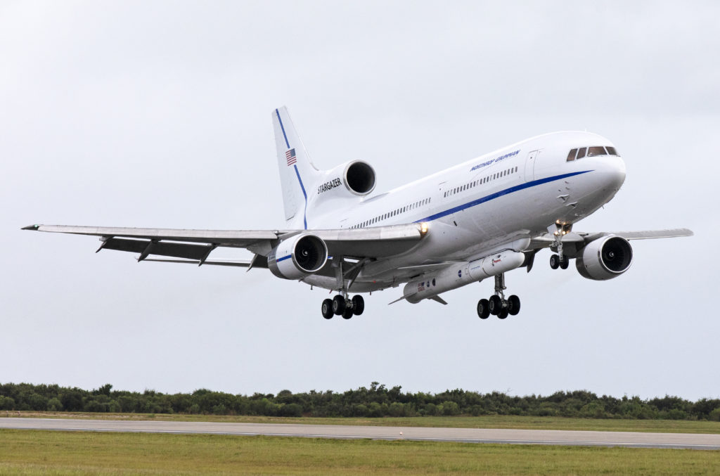 The Northrop Grumman L-1011 Stargazer aircraft lands on Oct. 19, 2018 at the Skid Strip at Cape Canaveral Air Force Station. A Pegasus XL rocket is attached to the underside of the aircraft with NASA's Ionospheric Connection Explorer, or ICON, satellite. Photo credit: NASA/Kim Shiflett