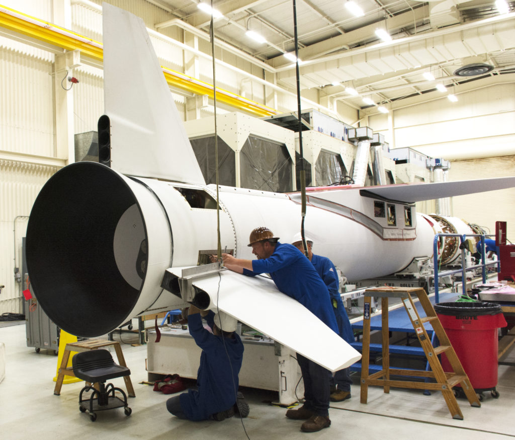 At Vandenberg Air Force Base in California, technicians install the starboard fin on the Northrop Grumman Pegasus XL rocket July 8, 2017. The Pegasus rocket is being prepared to launch NASA's Ionospheric Connection Explorer, or ICON, mission. Photo credit: Randy Beaudoin