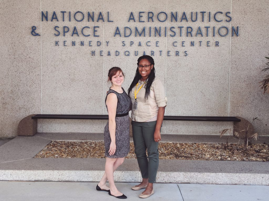 Sarah & Nicole in front of the KSC sign.