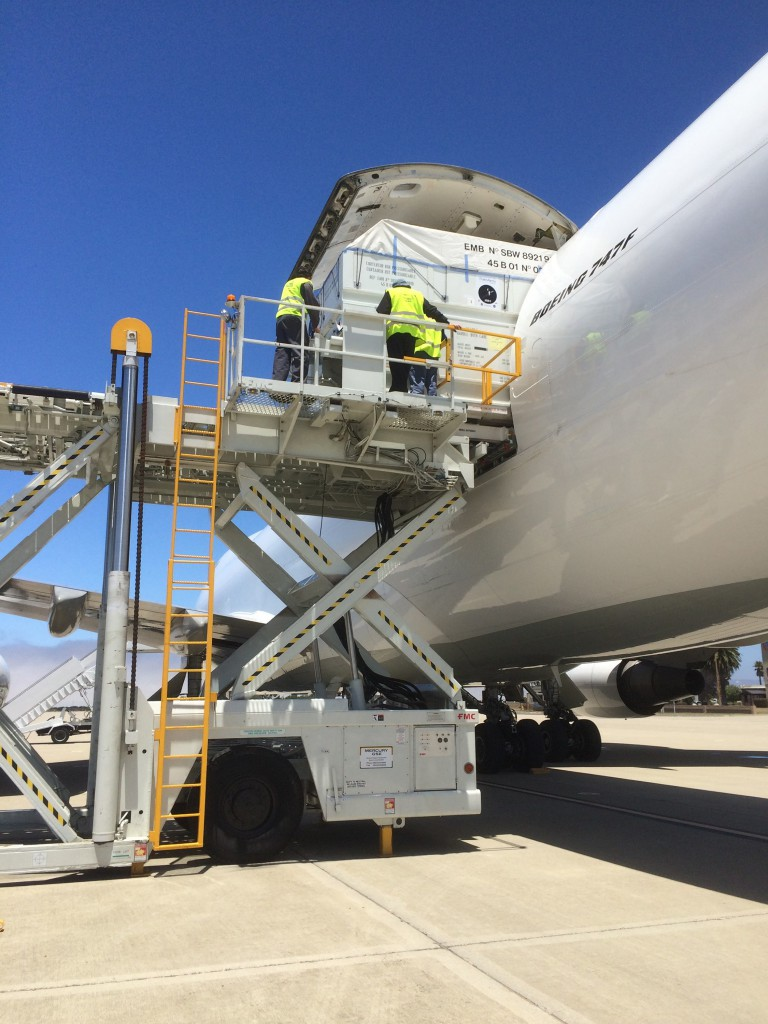 The shipping container holding the Jason-3 spacecraft is removed from the transport aircraft after its arrival at Vandenberg Air Force Base.