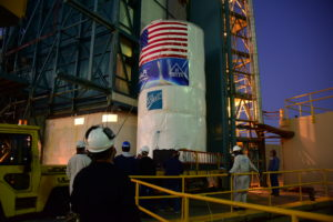 Packaged in a protective container, the Joint Polar Satellite System-1, or JPSS-1, spacecraft is about to be lifted and mated atop a United Launch Alliance Delta II rocket at Space Launch Complex 2 at Vandenberg Air Force Base in California.
