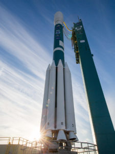 A ULA Delta II rocket carrying NOAA's JPSS-1 spacecraft stands poised for launch.