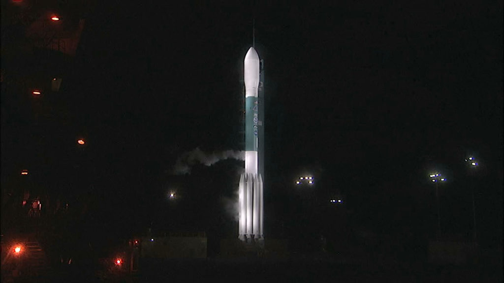 Gaseous oxygen vents away from the Delta II rocket as the vehicle awaits liftoff.