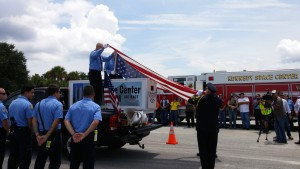 Flag removed from container carrying World Trade Center I-beam.