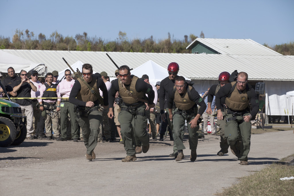 Members of NASA Kennedy Space Center's Emergency Response Team take off running during a challenge at the 33rd annual SWAT Round-up International in Orlando, Fla.