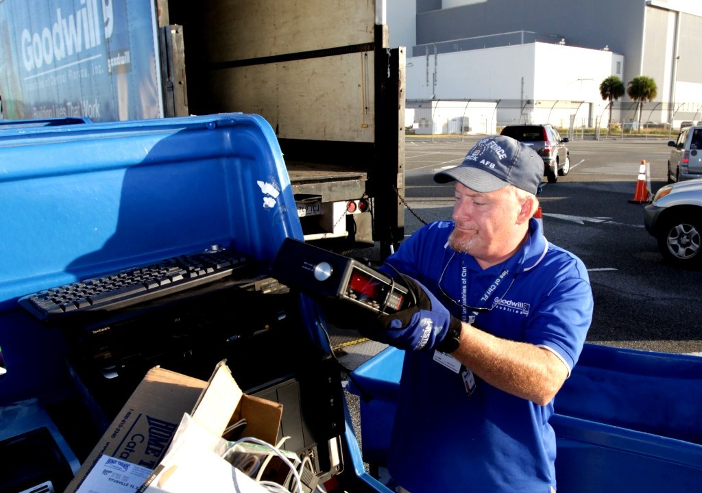 John Ryan of Goodwill Industries loads electronic equipment for recycling