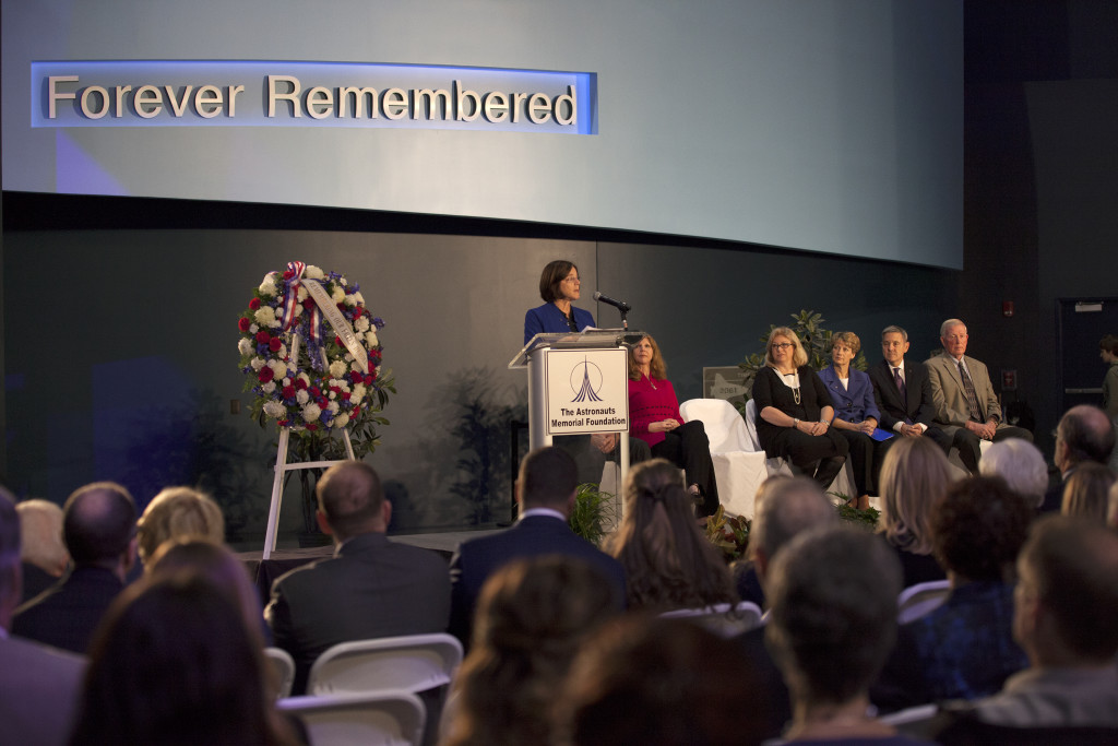 NASA astronaut Barbara Morgan speaks at Day of Remembrance ceremony as crew family members and officials look on