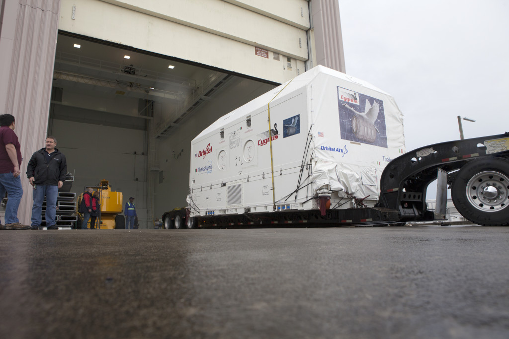 Orbital ATK CRS-6 Payload Cargo Module arrives by truck at Kennedy Space Center's Space Station Processing Facility