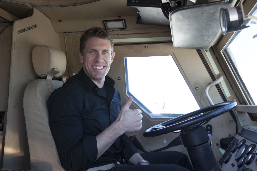 NASCAR Driver Carl Edwards drives MRAP around Pad 39B perimeter and visits the VAB. Photos by NASA/Bill White