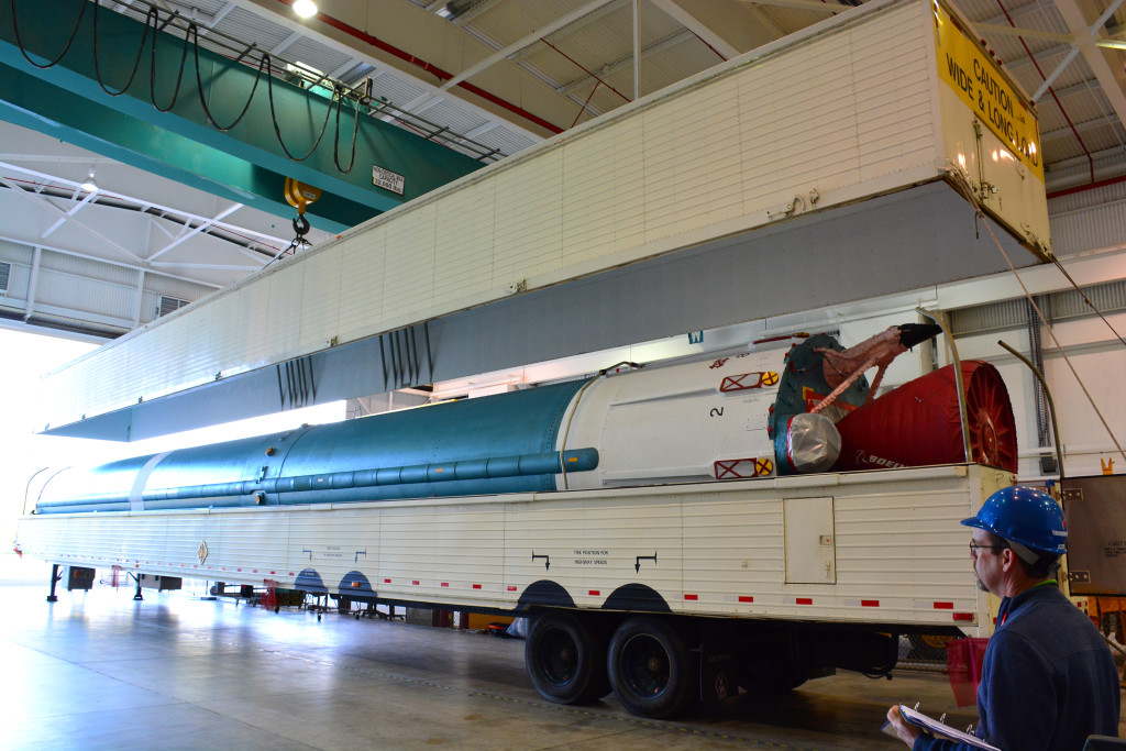 Delta II JPSS-1 booster offload and hoist onto the transport fixture at Bldg. 836 at Vandenberg Air Force Base, California.