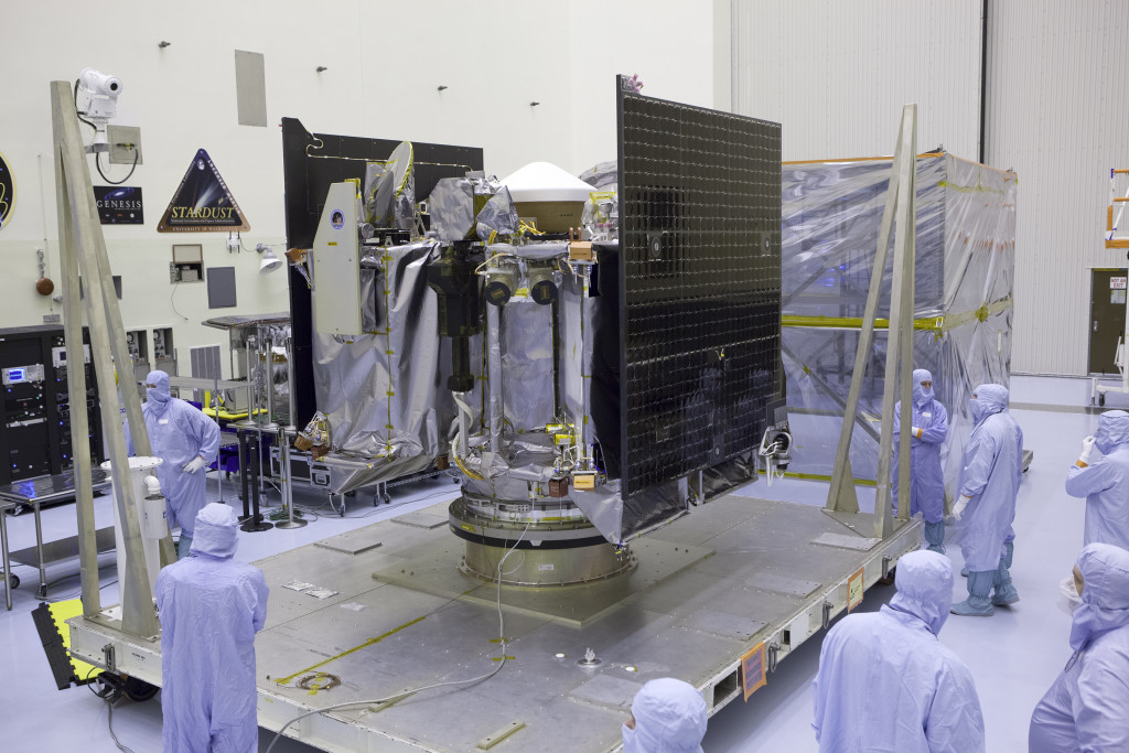 NASA's OSIRIS-REx spacecraft is revealed after its protective cover is removed inside the Payload Hazardous Servicing Facility at Kennedy Space Center in Florida.