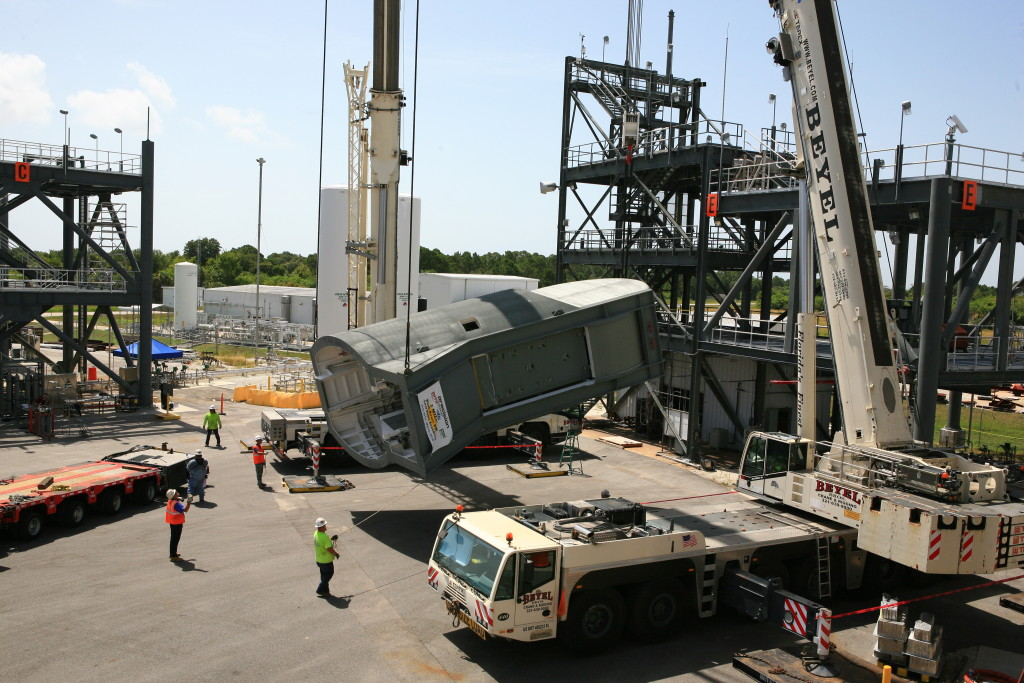 The first Tail Service Mast Umbilical arrives at Kennedy Space Center for Testing.