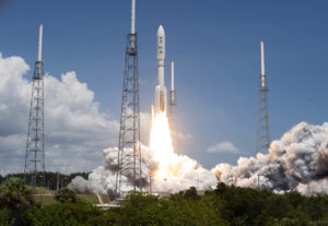 NASA's Juno planetary probe, enclosed in its payload fairing, launches atop a United Launch Alliance Atlas V rocket.