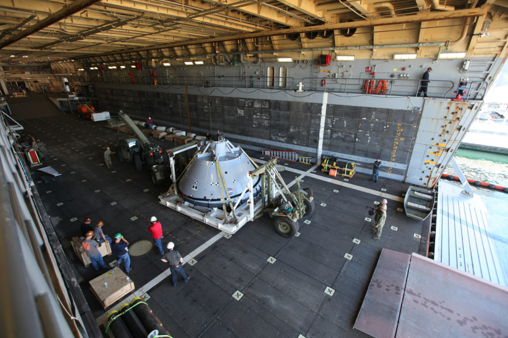 The test version of the Orion crew module was transported into the well deck of the USS San Diego at Naval Base San Diego in California on Oct. 21 to prepare for Underway Recovery Test 5.