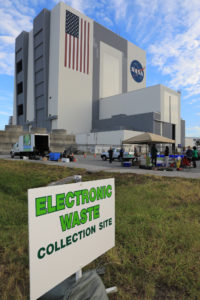 A sign points the way to the electronic waste collection site, where NASA Kennedy Space Center employees donated computers, monitors, vacuum cleaners and other electronics in conjunction with America Recycles Day.