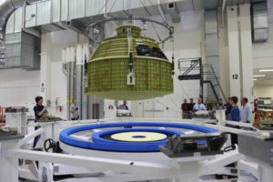 A crane lowers the Orion crew module structural test article onto a test tool called the birdcage Nov. 16.