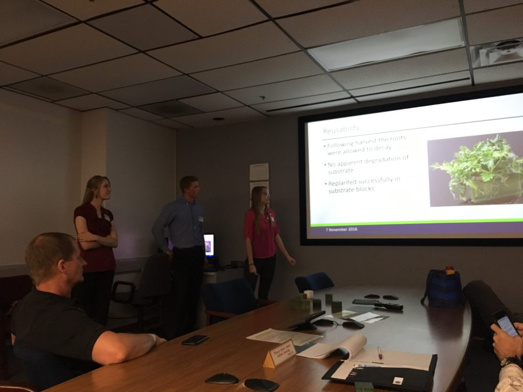 Utah State students Elizabeth Sherman, Emilee Madsen, Daniel Froerer, Zachary Jensen and Professor Timothy Taylor talk about their Eden project with Kennedy scientists and engineers.