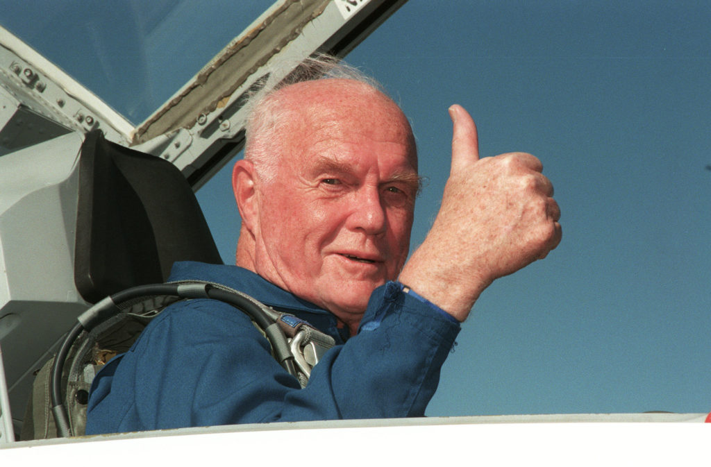 STS-95 Payload Specialist John H. Glenn Jr., senator from Ohio, gives a thumbs up on his arrival at Kennedy