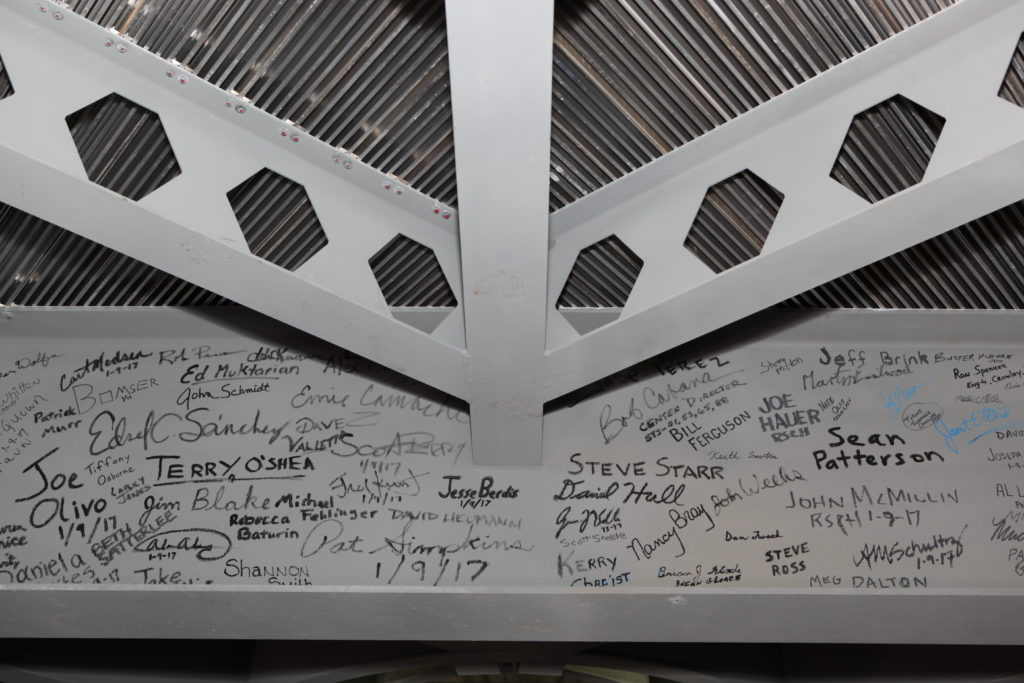 Workers sign final platform in the Vehicle Assembly Building.