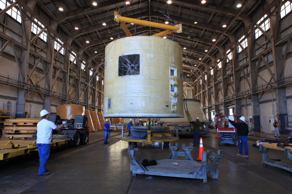The left-hand forward skirt for the Space Launch System solid rocket boosters arrives at Hangar AF.