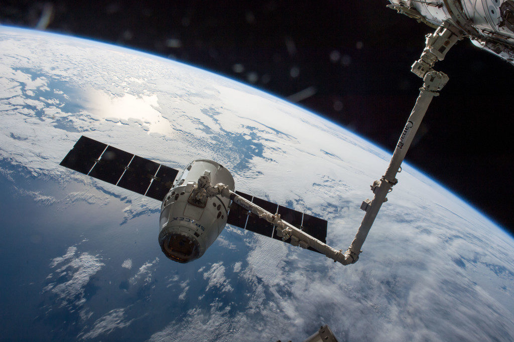 Dragon spacecraft captured by International Space Station arm