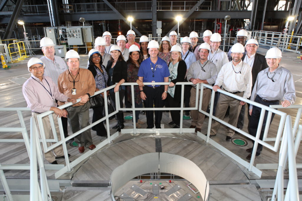 Members of NASA's Engineering Management Board pause for a group photo during a tour of the Vehicle Assembly Building at Kennedy Space Center in Florida.
