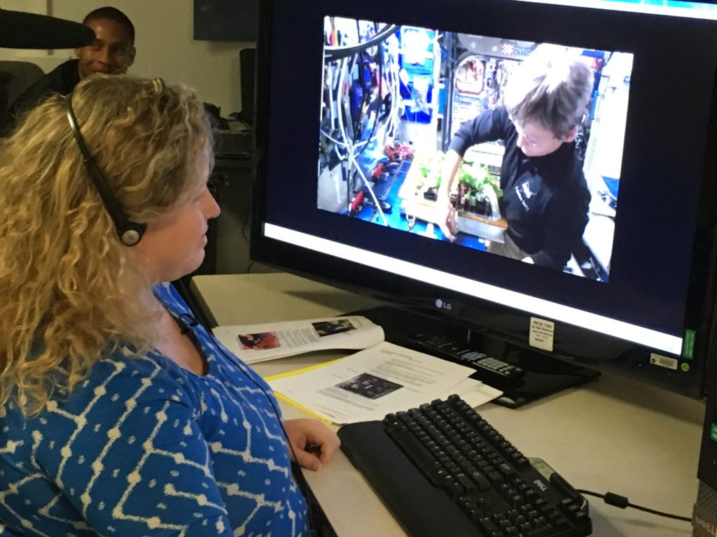 At Kennedy Space Center in Florida, Veggie Project Manager Nicole Dufour instructs astronaut Peggy Whitson during the first harvest of Chinese cabbage aboard the International Space Station last month. Today begins the grow out of the second Chinese cabbage crop aboard the orbiting laboratory.