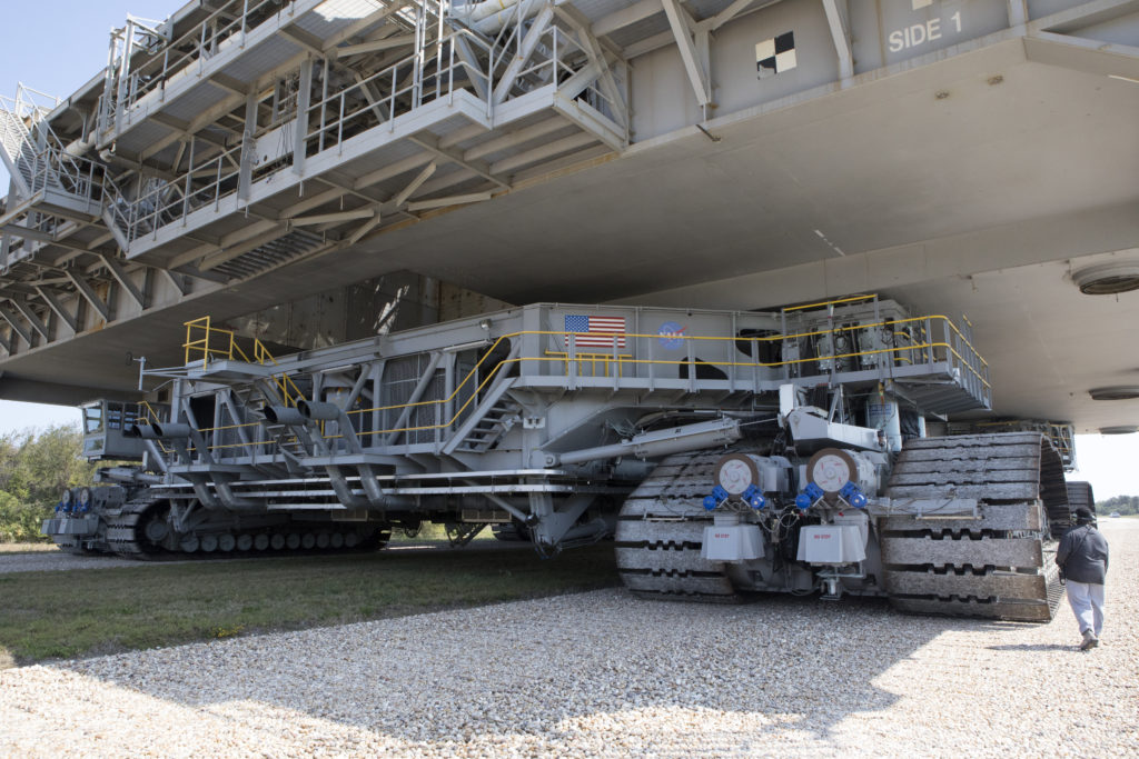 Crawler-transporter 2 with MLP-1 atop moves slowly along the crawlerway at Kennedy Space Center.