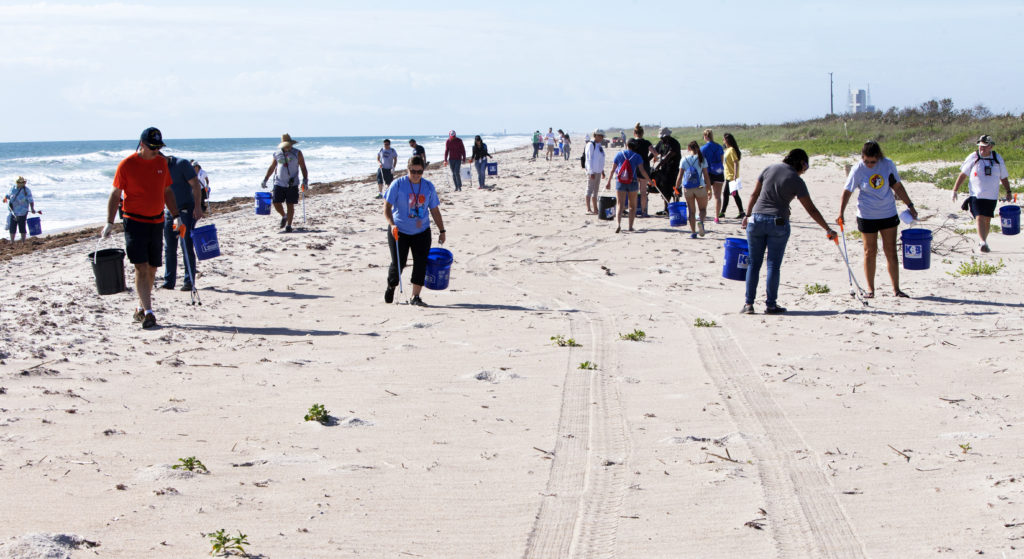 About 50 participants led by NASA Kennedy Space Center's Employee Resource Groups picked up about 20 bags of trash and other large debris along the center's shoreline before turtle-nesting season as a community service. Sea turtle-nesting season begins in about one month. Unlike what might be found along a public beach, all of the debris that litters Kennedy's restricted beaches washes ashore after being discarded at sea. Of the 72 miles of beach that form the eastern boundary of Brevard County, Florida, about six of those miles line Kennedy.
