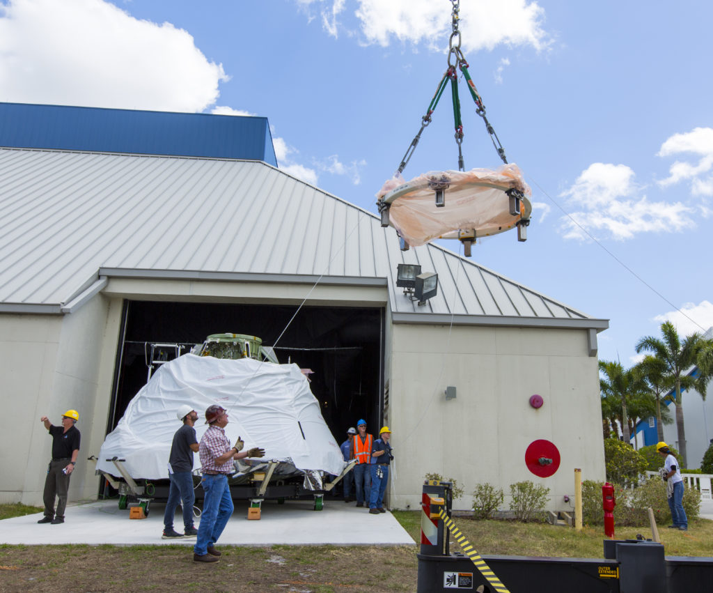 The Orion EFT-1 crew module is moved into the IMAX Theater at the Kennedy Space Center Visitor Complex in Florida.