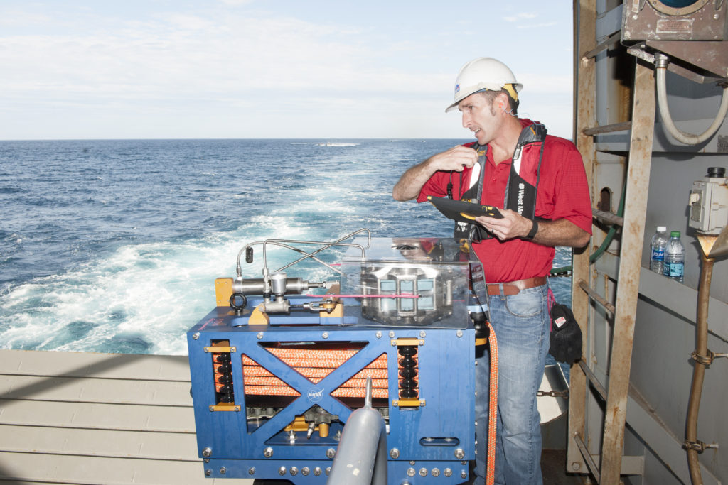 Jeremy Parr with the LLAMA during Orion Underway Recovery Test 5 in the Pacific Ocean.
