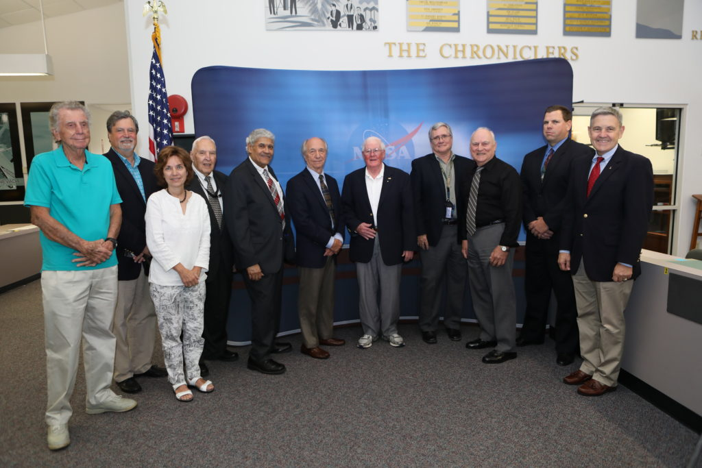 "Current and retired NASA Public Affairs team members and space journalists gather in the NASA News Center at Kennedy Space Center in Florida for a ceremony in which six new honorees were added to the ""Chroniclers"" roll of honor."