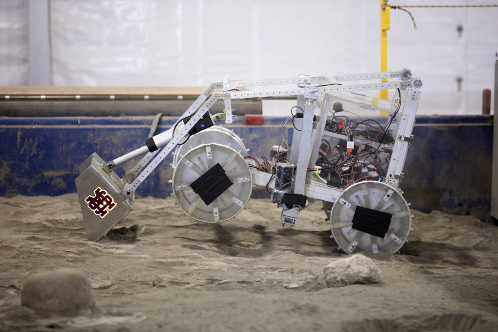 The robotic miner from Mississippi State University digs in the mining arena during NASA's 8th Annual Robotic Mining Competition at the Kennedy Space Center Visitor Complex in Florida.