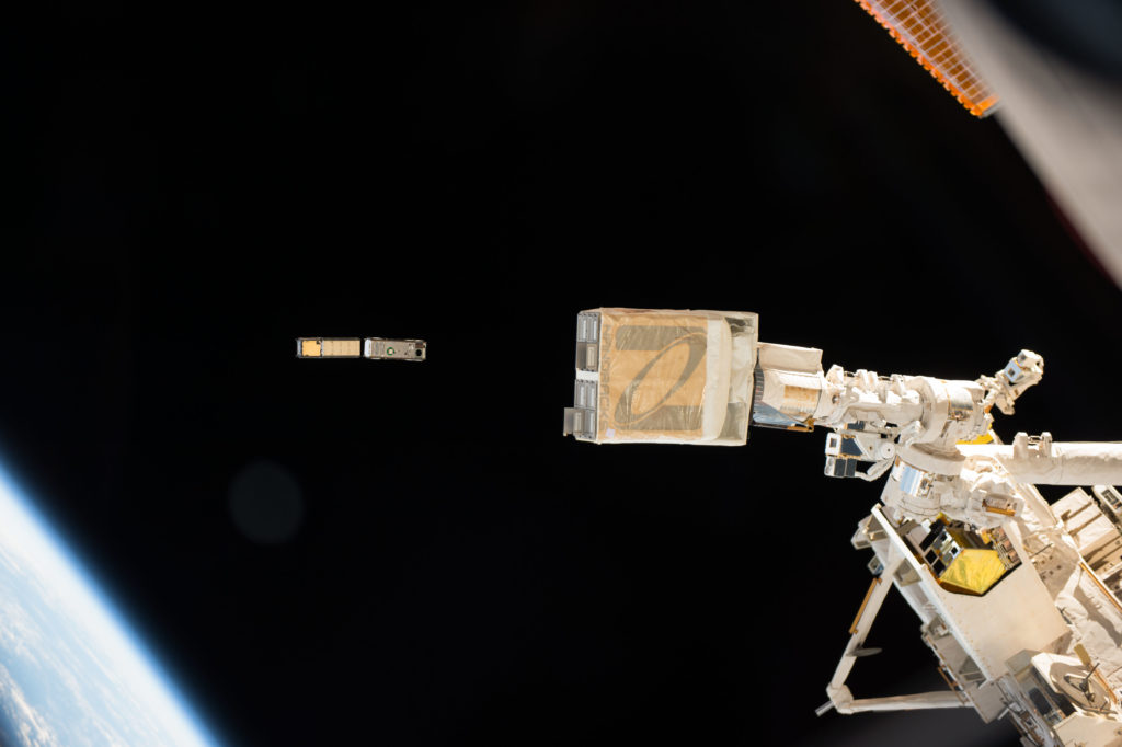 In this photo taken by NASA astronaut Peggy Whitson from inside the International Space Station cupola, the NanoRacks deployer (foreground) is clearly visible as the CXBN-2 and IceCube CubeSats deploy. CSUNSat-1 deployed on time two days later. The three CubeSat payloads make up NASA's ELaNa 17 mission which launched in April aboard the Orbital ATK Cygnus spacecraft on a commercial resupply flight to the station.