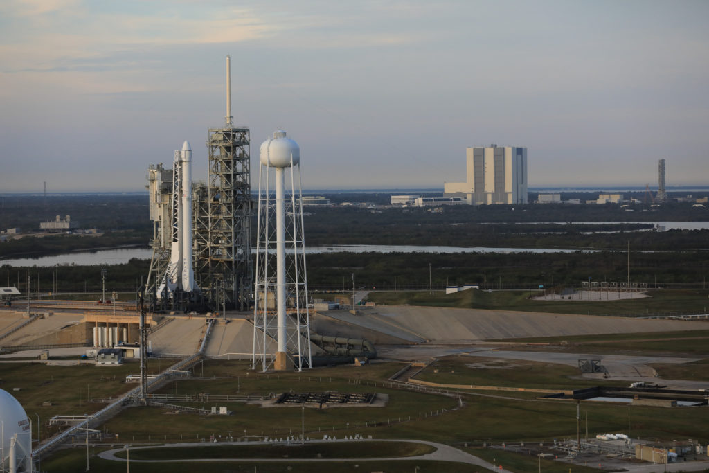 A SpaceX Falcon 9 rocket and Dragon spacecraft await liftoff from Kennedy Space Center's Launch Complex 39A in April 2017.