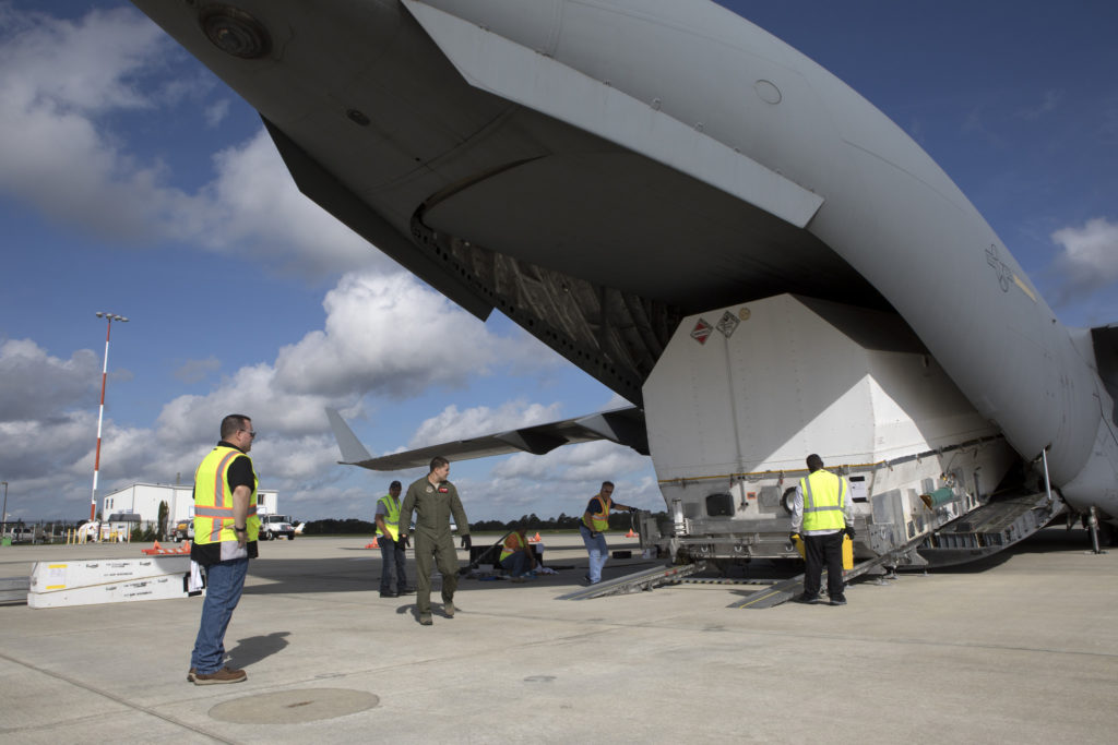 NASA's TDRS-M satellite arrives inside its shipping container at Space Coast Regional Airport in Titusville, Florida, aboard a U.S. Air Force transport aircraft.