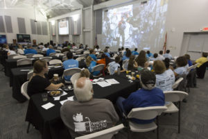 Students and sponsors hear from astronauts aboard the International Space Station on a big screen in the Center for Space Education at NASA's Kennedy Space Center in Florida.