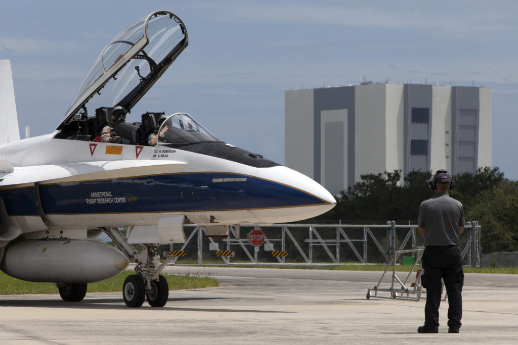 A NASA F-18 jet is prepared for takeoff from the agency's Shuttle Landing Facility at NASA's Kennedy Space Center in Florida. Several flights a day have been taking place the week of Aug. 21, 2017 to measure the effects of sonic booms. It is part of NASA's Sonic Booms in Atmospheric Turbulence, or SonicBAT II Program.