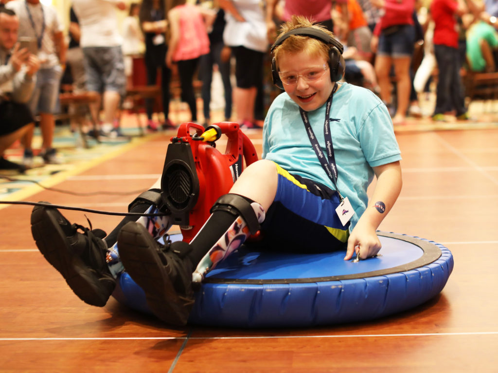 Dreamflight Participant on a hoverboard at NASA Night