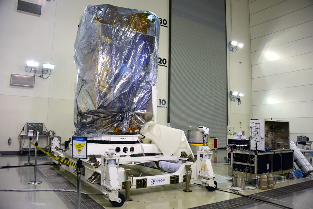 NOAA's Joint Polar Satellite System-1, or JPSS-1, remains wrapped in a protective covering after removal from its shipping container at the Astrotech Processing Facility at Vandenberg Air Force Base in California. The spacecraft is being prepared for its upcoming liftoff aboard a United Launch Alliance Delta II rocket from Vandenberg's Space Launch Complex-2W. JPSS-1 is the first in a series four next-generation environmental satellites in a collaborative program between NOAA and NASA.