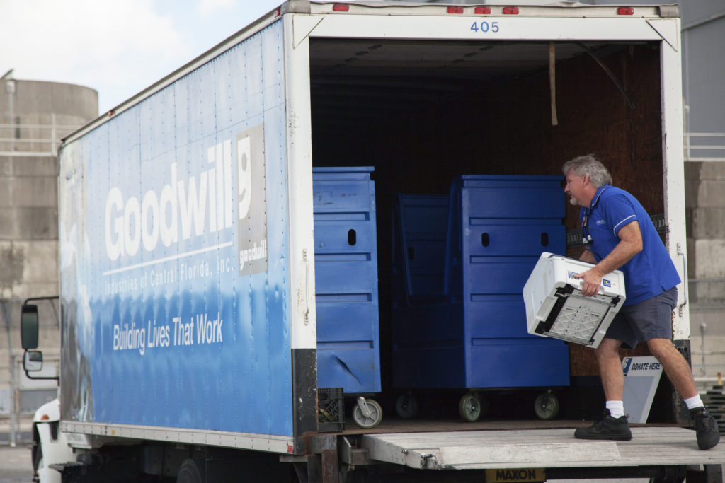 In the parking lot of the Vehicle Assembly Building at NASA's Kennedy Space Center, a member of Goodwill Industries loads used household material for recycling. During the two-day event, employees dropped off items as part of America Recycles Day. Photo credit: NASA/ Michelle Stone