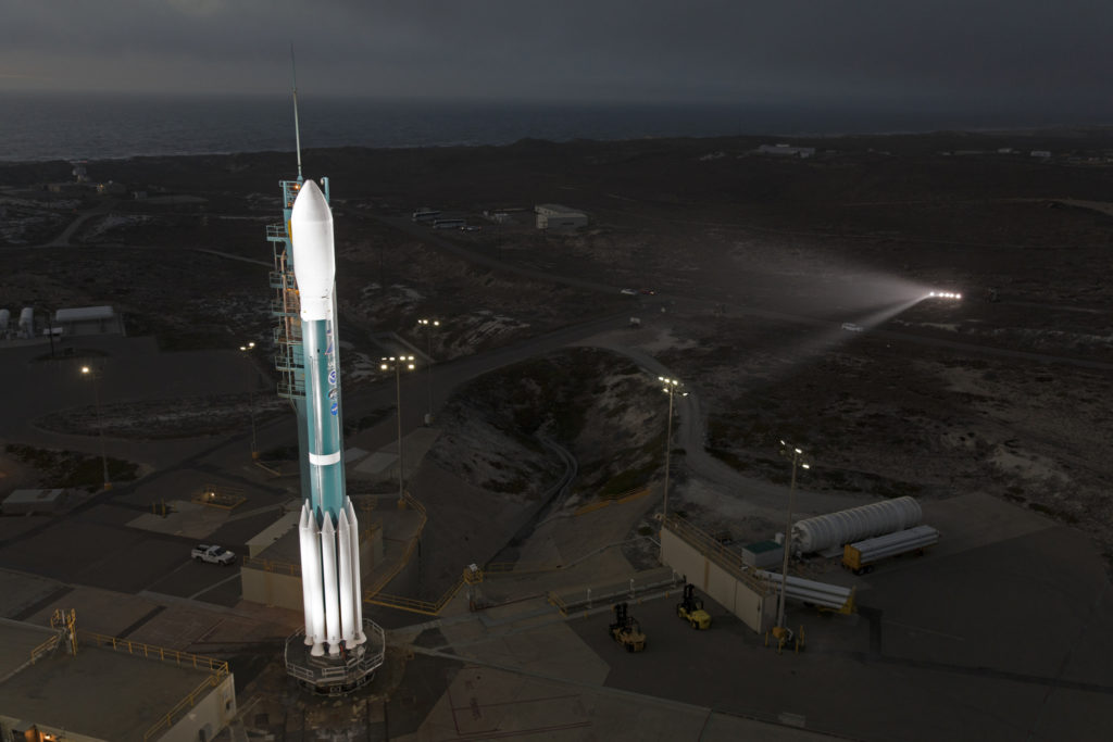 The tower rolls away from the Delta II rocket set to launch NOAA's JPSS-1 spacecraft.