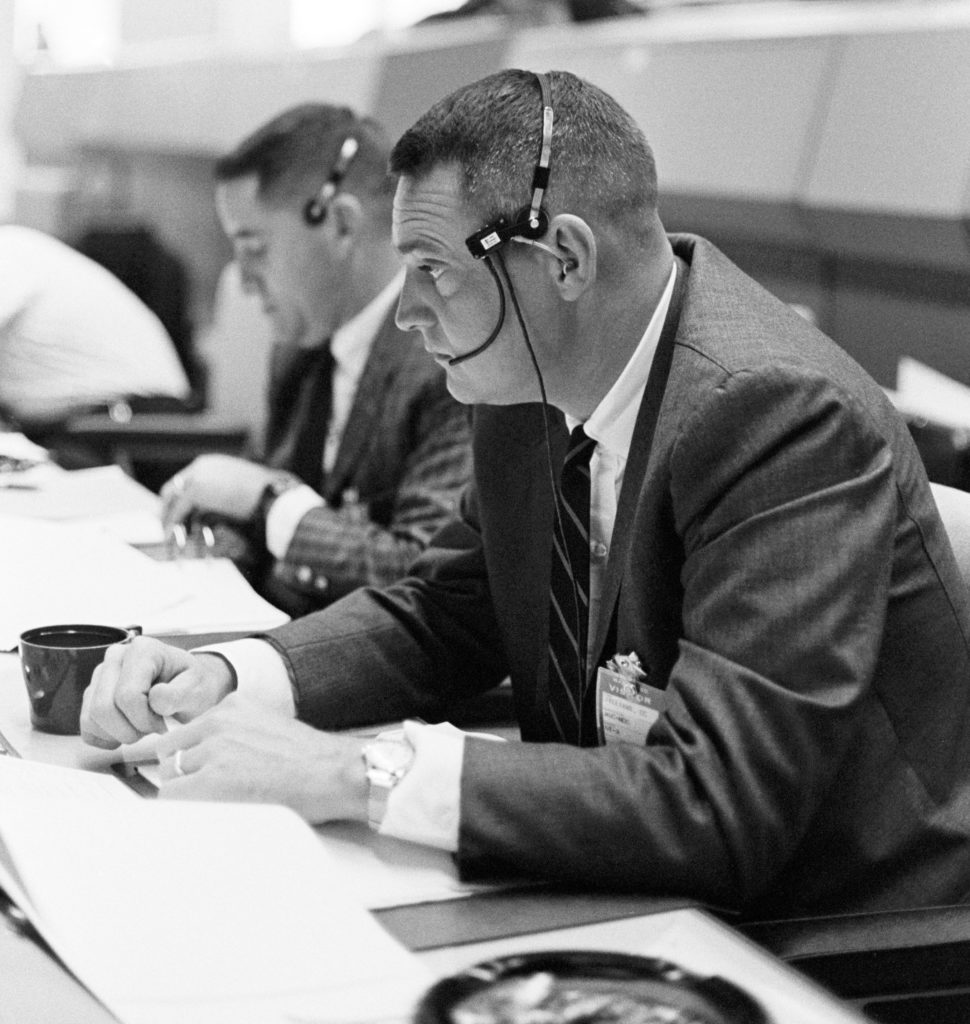 On March 23, 1965, NASA astronaut Clifton Williams monitors the Gemini III flight from the Mission Control Center in at the Manned Spacecraft Center (now Johnson Space Center).Houston. While Gemini III was controlled by the Mission Control Center at Cape Kennedy (now Cape Canaveral) Air Force Station, future missions would be controlled at the new space center in Texas.