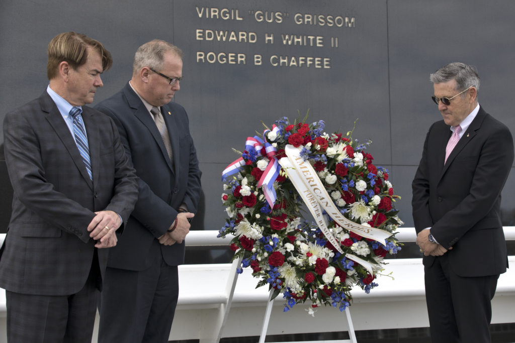 During the 2018 Day of Remembrance at NASA's Kennedy Space Center, from left, State Sen. Thad Altman, president and CEO of the Astronauts Memorial Foundation, Therrin Protze, chief operating officer of Delaware North, and Center Director Bob Cabana place a wreath at the Space Mirror Memorial.