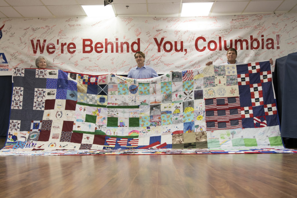 A giant hand-made quilt was turned over to the Columbia Preservation Room at NASA's Kennedy Space Center in Florida.