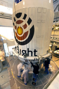 Technicians and engineers position NASA's Interior Exploration using Seismic Investigations, Geodesy and Heat Transport (InSight) Mars Lander atop a United Launch Alliance Atlas V rocket at Space Launch Complex 3 at Vandenberg Air Force Base in California.