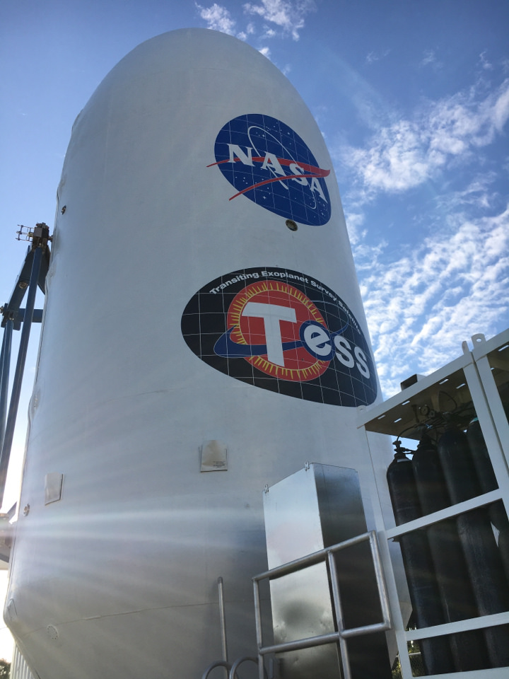 The payload fairing for NASA's Transiting Exoplanet Survey Satellite (TESS) is being moved to the Payload Hazardous Servicing Facility at the agency's Kennedy Space Center in Florida. Inside the facility, TESS will be encapsulated in the payload fairing.