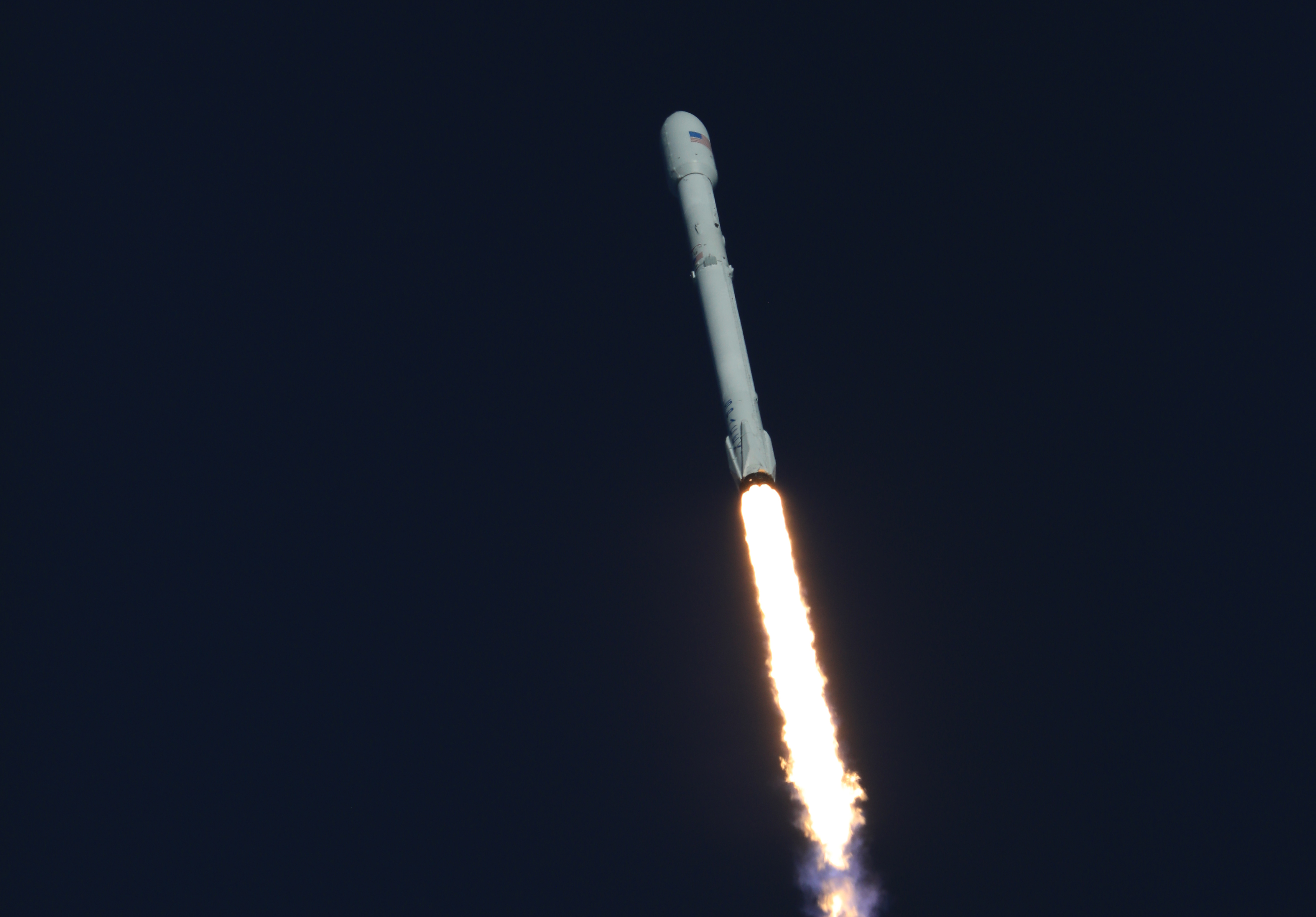 A SpaceX Falcon 9 rocket soars upward after lifting off from Space Launch Complex 40 at Cape Canaveral Air Force Station in Florida, carrying NASA's Transiting Exoplanet Survey Satellite (TESS). Liftoff was at 6:51 p.m. EDT.
