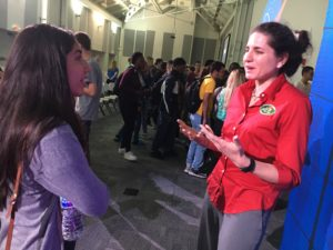 Nicole Figueroa, a Pine Ridge High School student, speaks with Gioia Massa, a life sciences project scientist at KSC, after an event that highlighted NASA's partnership with The Fairchild Challenge to efforts to identify plants suitable for growing in space.